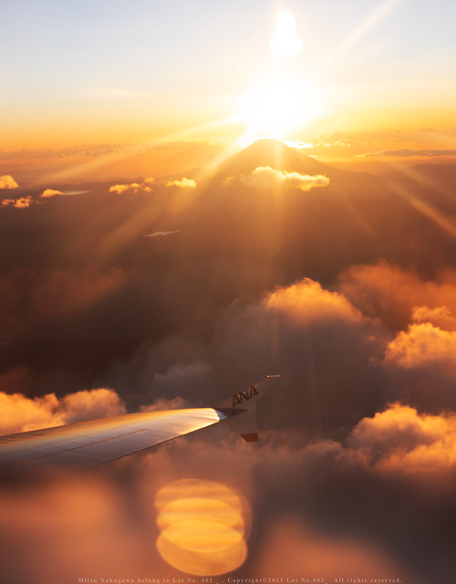 First sunrise = wings + Mt. Fuji + light