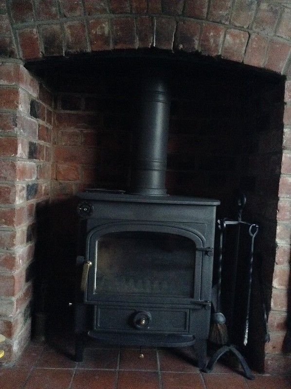A nice clean log stove and chimney