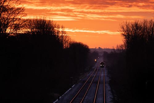 150275 woodlesford leeds sunrise dawn red sky northern railway train