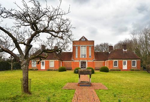 hampshire england winter march 2016 sandhammemorialchapel chapel building garden path well tree burghclere
