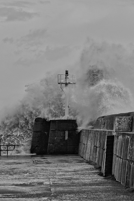 Waves Crashing against Pier