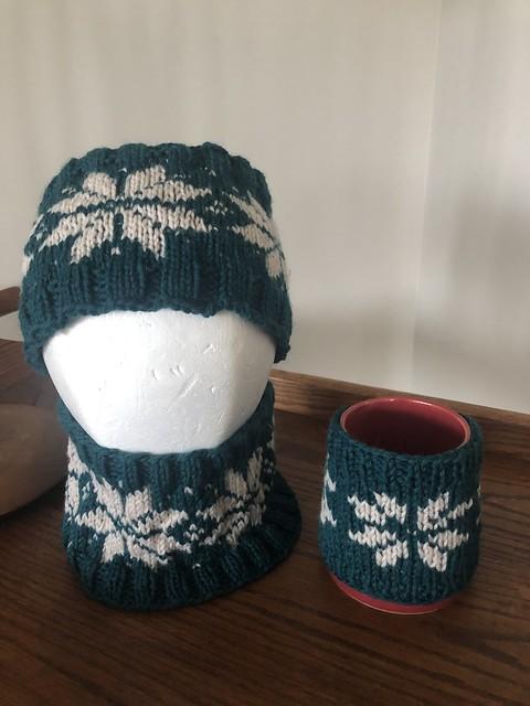 Angela finished Maja's wintery headband and Fair Isle snowflake mug cosy.