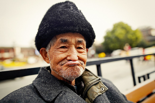 A portrait of an old man with black fur hat