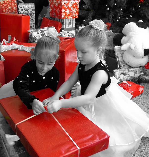 Opening Christmas presents, in selective color
