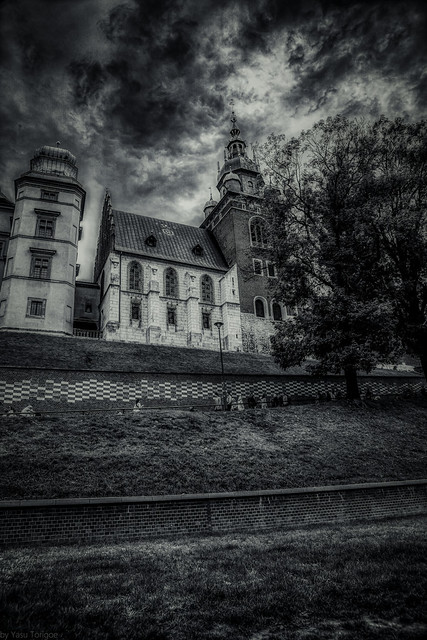 Black and white version of the view of the Wawel Castle Cathedral from the Podzamcze street from where the visitors climb the long path to the Castle, Krakow, Poland.  684-Editbw