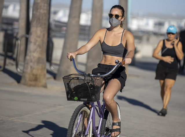 Masked girl on bike
