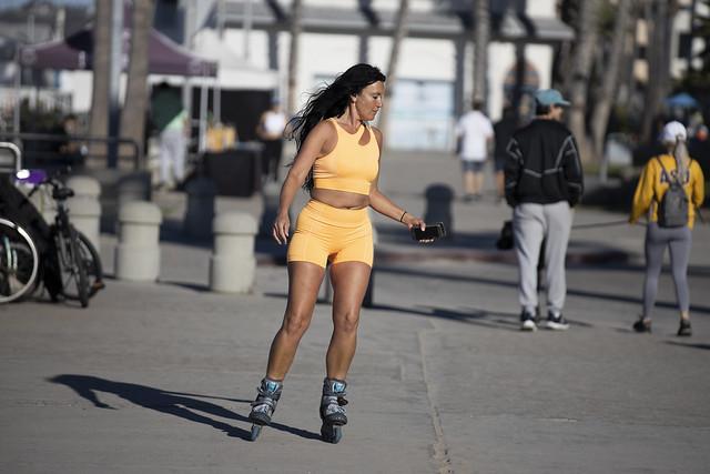 Yellow roller skating woman