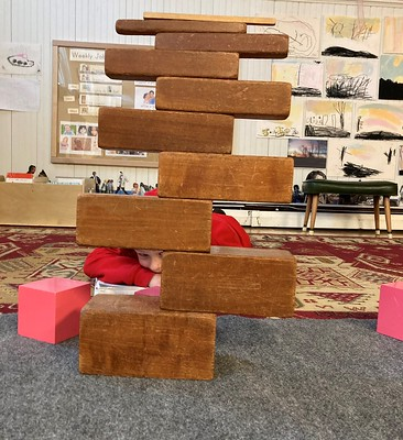 brown stairs balancing with pink tower cubes pulled out