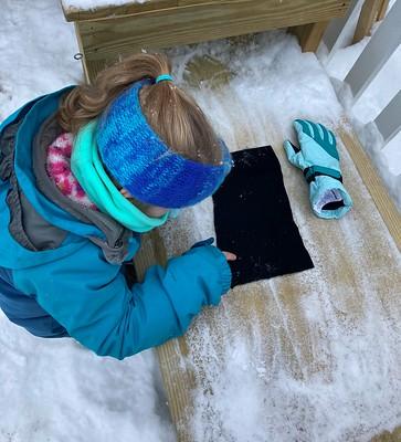 examining snowflakes