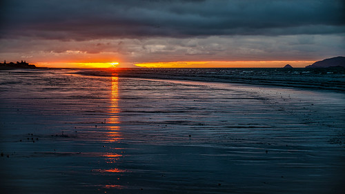 <p>... we had a rather unusual sunset last night, with low lying storm clouds over the South Island, there was little room for the sun to set behind the Southern Alps, leaving a horizontal slice of orange in the sky...</p>