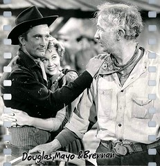 Kirk Douglas, Walter Brennan, and Virginia Mayo