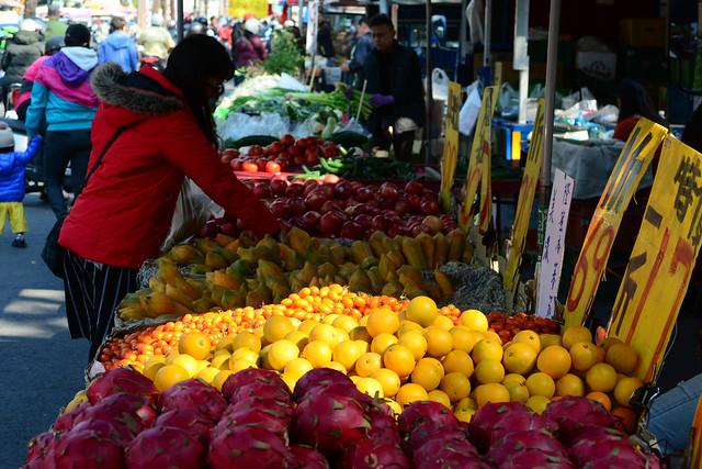 Woman Choosing Papayas