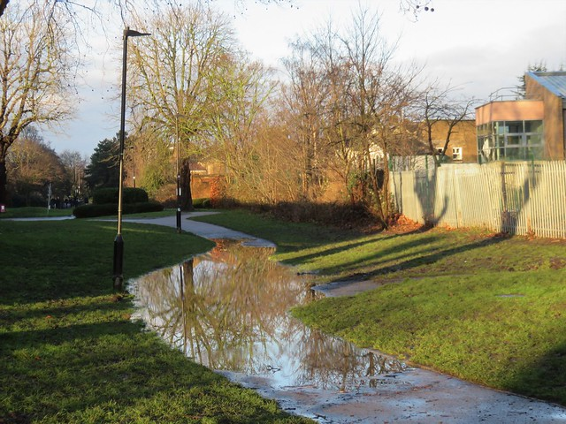 There's water everywhere after the downpour: a blocked drain gully on the New River Path, Trinity Road, Wood Green