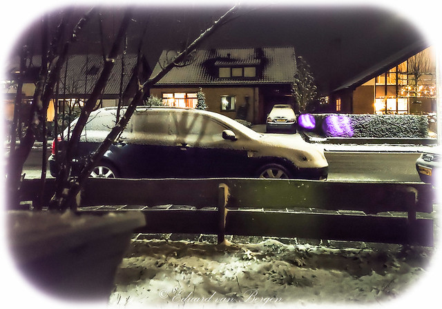 Well, last night I made a picture of the first -and probably last- snow of this winter, but as it turns out, I also captured a little ghost family on the other side of the street. Mom & dad with their offspring, floating in their protective bubble.