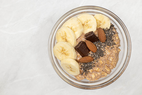 Top view of Oatmeal with Bananas Chocolate and Chia | by wuestenigel