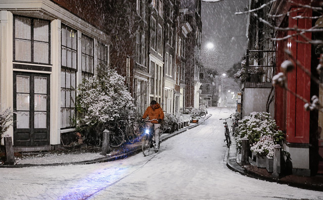 Cycling through the snow shower in Amsterdam's Jordaan