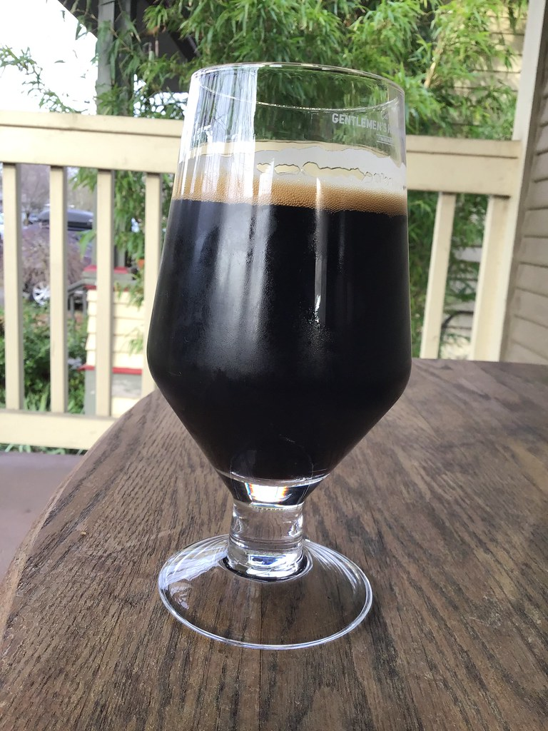 Masthead Single Origin Coffee Stout in glass, on table outdoors