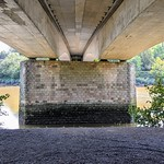 Under the bridge over the river