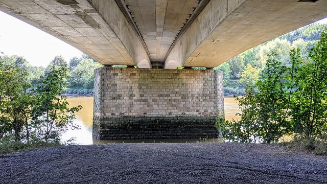 Under the bridge over the river