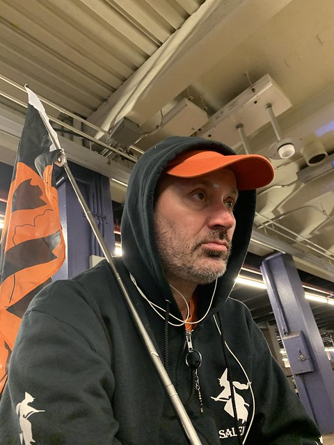 Ryan Janek Wolowski flying Halloween Witch Flag waiting for the NYC MTA Subway E train NYC USA October 31st 2020