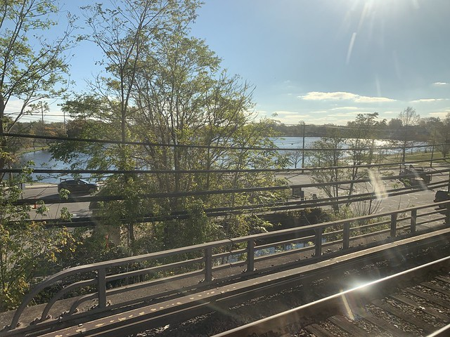 Long Island Rail Road LIRR to Penn Station NYC autumn foliage with reflecting lake on Long Island NY Halloween October 31st 2020