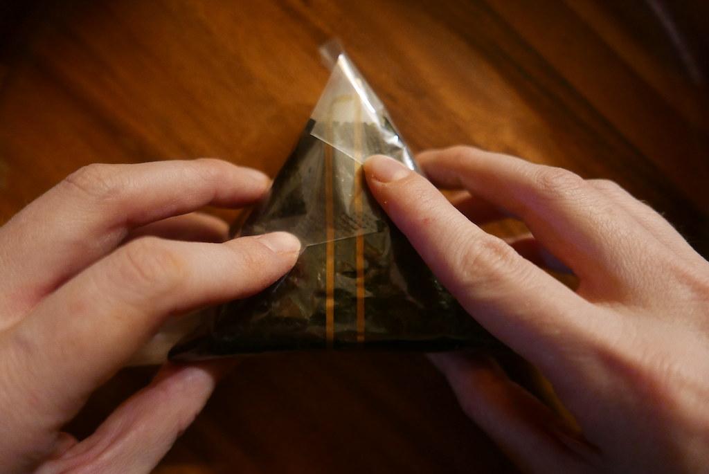 Overhead shot of the corners folding over the rice to create a triangle shape.
