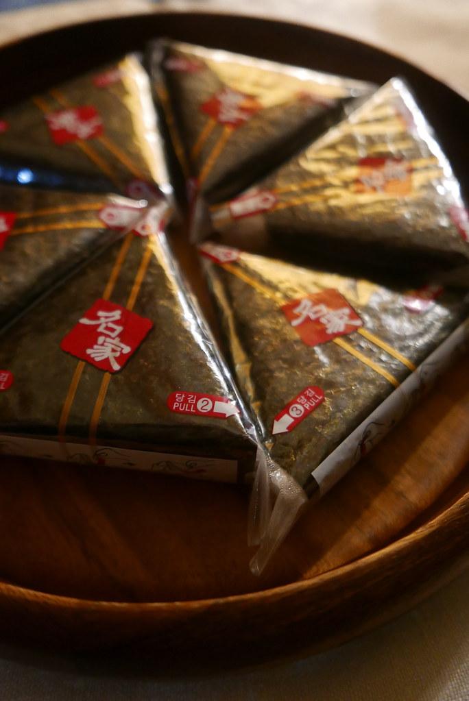 Triangle Kimbap laying on a platter.