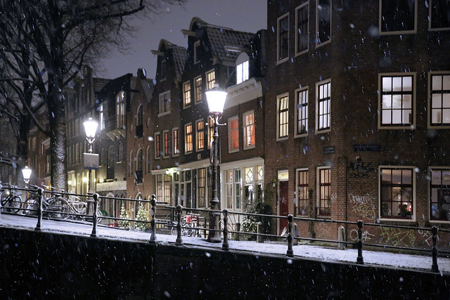 Many Amsterdam residents stay warm inside when the first snow falls