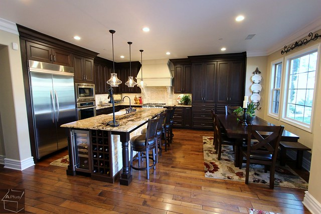 Kitchen Remodel with Aplus Custom dark cabinets, dining table, white hood & brand new wood floors in city of San Clemente, Orange County https://www.aplushomeimprovements.com/portfolio_page/san-clemente-orange-county-traditional-kitchen-remodel-95/