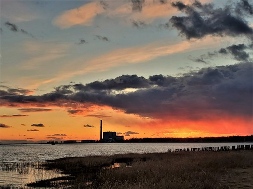 63 norwalkct calfpasturebeachnorwalkct sunset sky clouds winter longislandsound powerplant