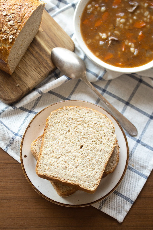 Sliced Honey Oat Bread with a Bowl of Soup