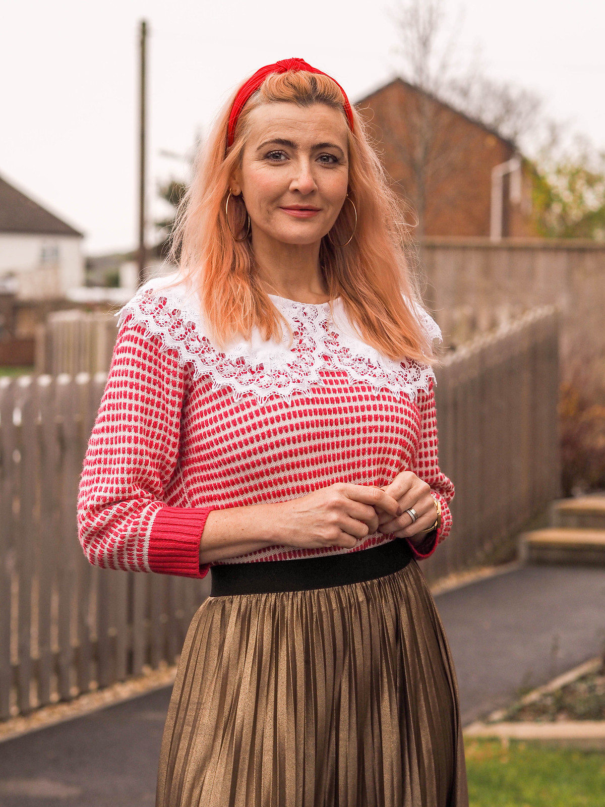 Christmas Day Outfit: Oversized white lace colour, white/red patterned sweater, gold pleated maxi skirt, red heels, red headband | Not Dressed As Lamb, Over 40 Fashion