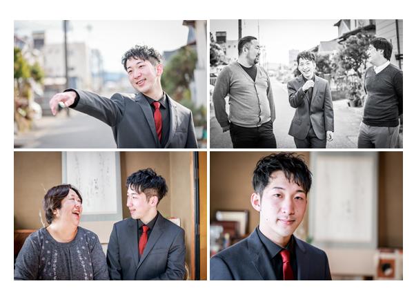 自宅で新成人を祝う 20歳の男性 黒のスーツに赤いネクタイ