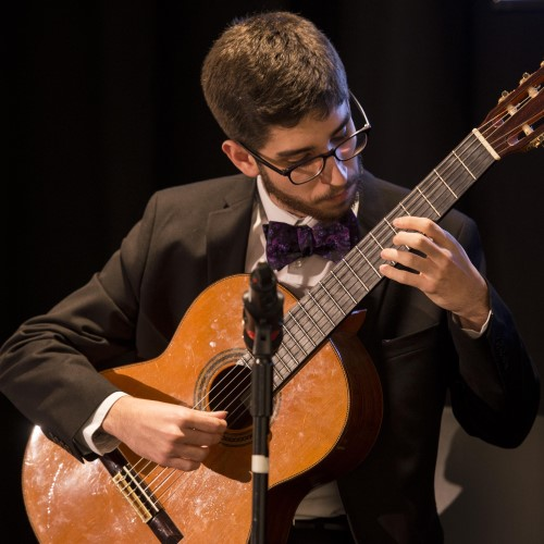 Photo of a student playing classical guitar