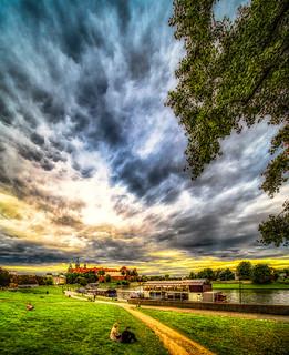 Clouds over Wawel Castle and Vistula River, Krakow, Poland.  706-Edita