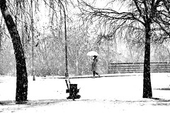 Young girl walking alone in a snowy morning
