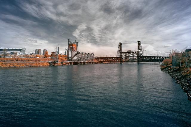 Steel Bridge Crossing The Willamette River - Portland, Oregon