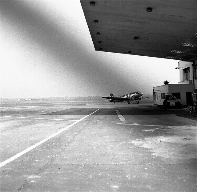 An Aer Lingus Douglas C-47 Dakota taxies to the terminal at Elmdon Airport Birmingham in about 1958. Scanned from a negative originally in the Will Blunt collection and now in the Jute collection.