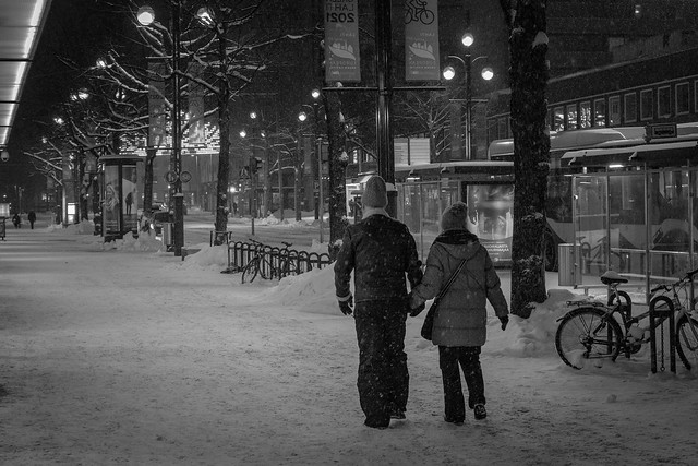 A Lovely Elderly Couple in Snow in the Night