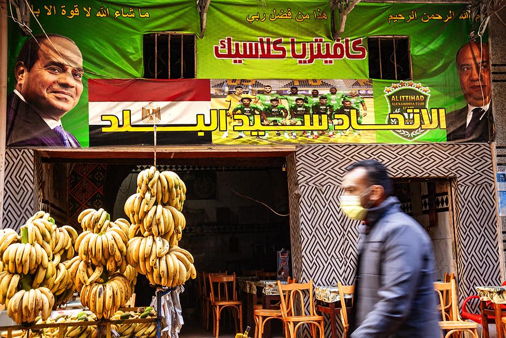 Al-Sisi on banner over coffee house on 1-20-21--Alexandria