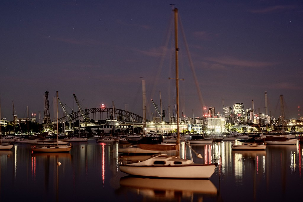 Under a hint of pre dawn cloud, and looking across Rushcutters Bay to the wider Sydney Harbour, you can see the Harbour Bridge on the lectins North Sydyto the right.