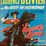 Wed, 2021-01-20 09:52 - When the composer of an opera about a swashbuckling, wenching highwayman meets his hero's real-life counterpart, he's disappointed with his lack of dash.  This film version of John Gay's 1728 ballad opera is directed by Peter Brook and stars Laurence Olivier, Dorothy Tutin, Stanley Holloway and others.  Olivier and Holloway do their own singing in the film, but Dorothy Tutin and several others were dubbed.     Scene from the movie: www.youtube.com/watch?v=nU6p3Ubq42U&list=PLzY8m1u5A-E...