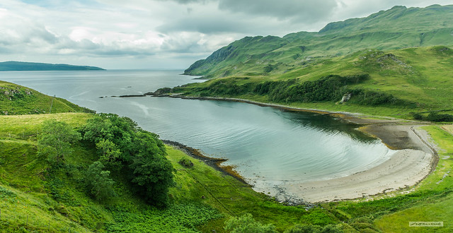 The verdant, sumptuous beauty of Camus nan Geall, Ardnamurchan, with Ben Hiant, top right. Mull, top left and Coll and Tiree on the horizon.