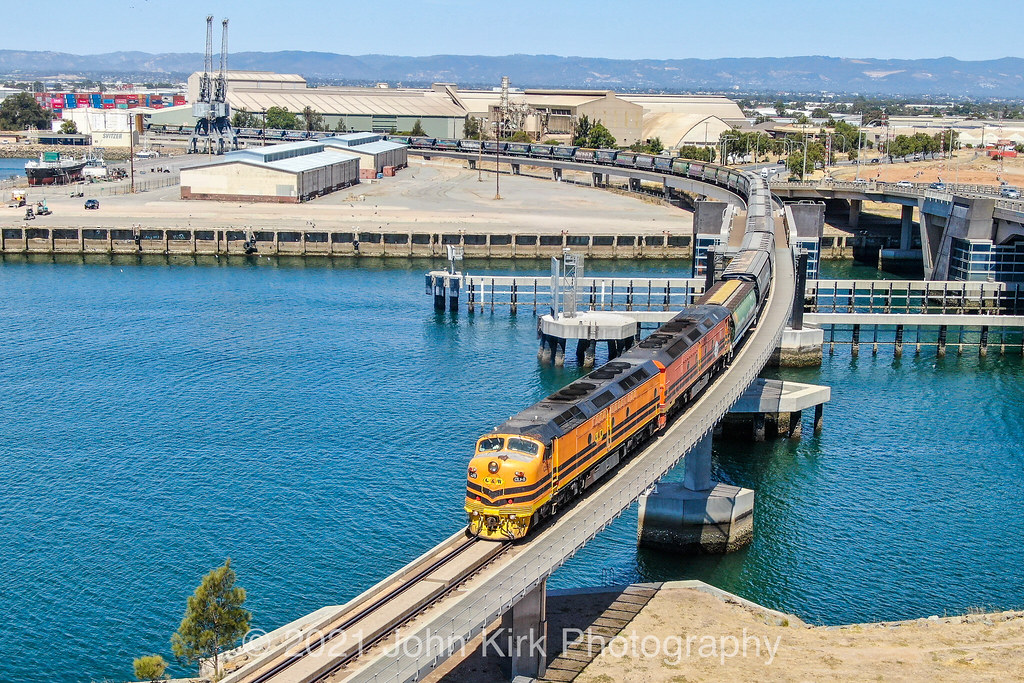 Two Shades of Orange on the Port River by Beyond Trains