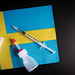 Vaccine vial. Medical syringe with needle for protection flu virus and coronavirus with flag of Sweden