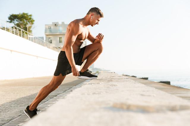 Strong mature sportsman make exercises