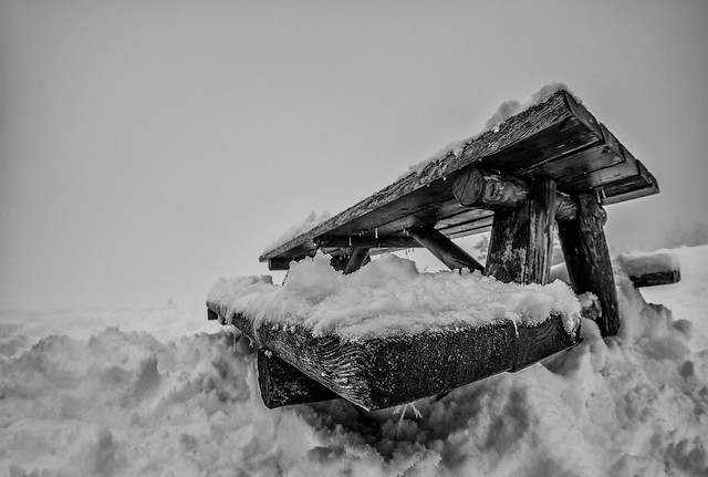 a cold wooden bench