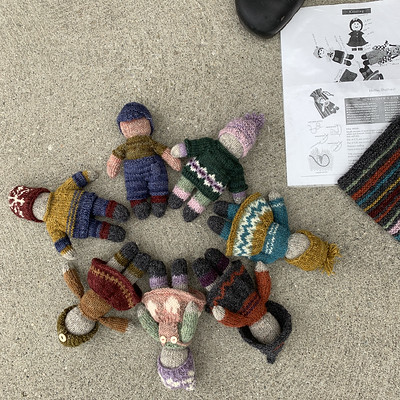 Angela brought this wonderful set of tiny dolls and the matching bag to hold them when came to pick up her Draw prize! They are knit using scraps of Lichen and Lace Rustic Heather Sport leftover from her stranded sweaters!