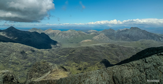 Summit view from Sgurr Alasdair, Isle of Skye, of Black and Red Cuillins with Mainland on the horizon.