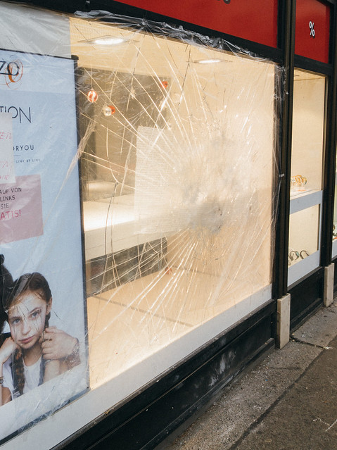 Broken storefront glass of a watch shop